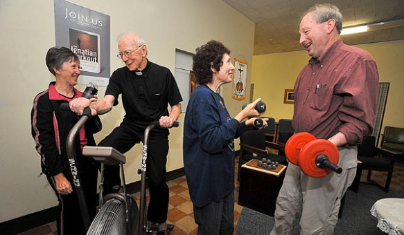 Sister Mary Lou Schnitzer, SSJ, (left to right) Father Richard J Hoar, SJ, Gini Schultz and Joseph Ritzert exercise their bodies as well as their minds with the Ignatian Workout. (Patrick McPartland/Staff Photographer)