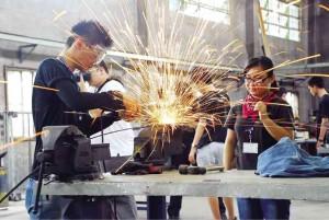 Participants learn welding at Erda. Photo: Brian Maraña