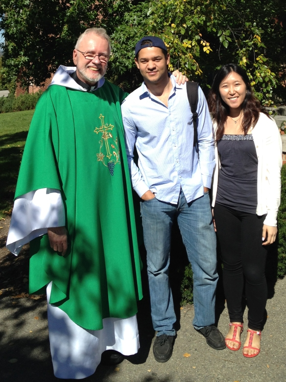 Fr. Carsten P. Martensen, SJ, Catholic Chaplain at both Ithaca College and Cornell University is pictured with two students from Cornell University after Mass this past Sunday.