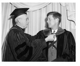 Senator John F. Kennedy receives an honorary degree from Laurence J. McGinley, SJ, president of Fordham, at the Fordham Law Association luncheon on Feb. 15, 1958.