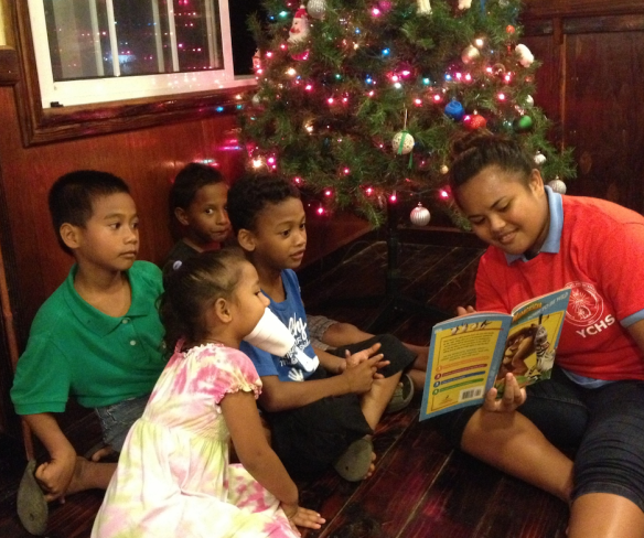 A student from Yap Catholic High School in Micronesia reads to children visiting the school for the annual Evening of Lessons and Carols. Click here to read more about Christmas on Yap and click here to view more photos.