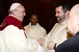 Fr. Rogers shaking hands with Pope Francis.