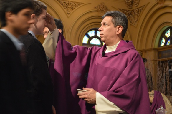 Fr. Ralph Rivera, SJ, chaplain and theology teacher at Xavier High School in New York City, distributes ashes to students.