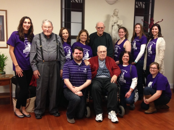 Several alumni from the University of Scranton spent a service day at Murray-Weigel Hall in the Bronx spending time with the elderly and infirm Jesuits there. Pictured above with the alums are Fr. Robert Haus, SJ, (left) Fr. Paul Dugan, SJ, (seated) and Fr. William McCurdy, SJ, (right).