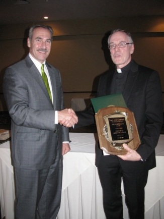 On May 30, Fr. Edward Quinnan, SJ, was honored by his alma mater Pius X Jr/Sr High School with the Religious Education Award at their 11th Annual Royal Gala. It was presented in recognition of his service to God's people through the ministry of the Spiritual Exercises and making Ignatian spirituality accessible to those seeking God in all things. Pictured right, Fr. Quinnan receives his award from Mario Lucrezi, school principal.