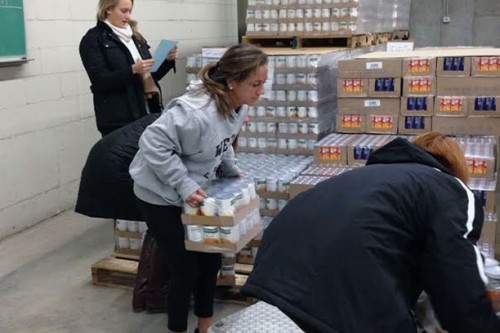 "For the past five years the Holy Cross women's lacrosse team has been volunteering with Catholic Charities and the Worcester County Food Bank to serve those in need. ""We want to give back to the community in Worcester and do our part to make sure that everyone has their basic needs met,"" said Stephanie Ridolfi, head coach of the women's lacrosse team. Click here to read more about how these students strive to be women for others."
