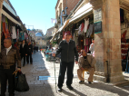 Fr. Keenan poses with his walking stick in front of the old market section in Jerusalem.